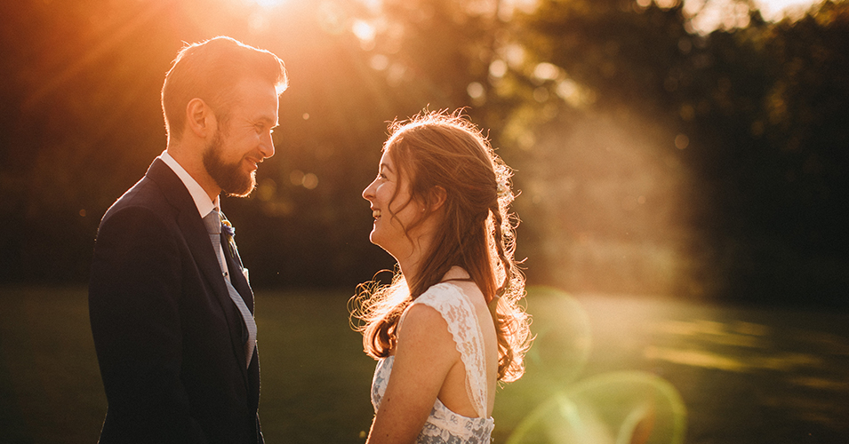 The happy bride and groom share a moment in the beautiful sunset at Morden Hall in London