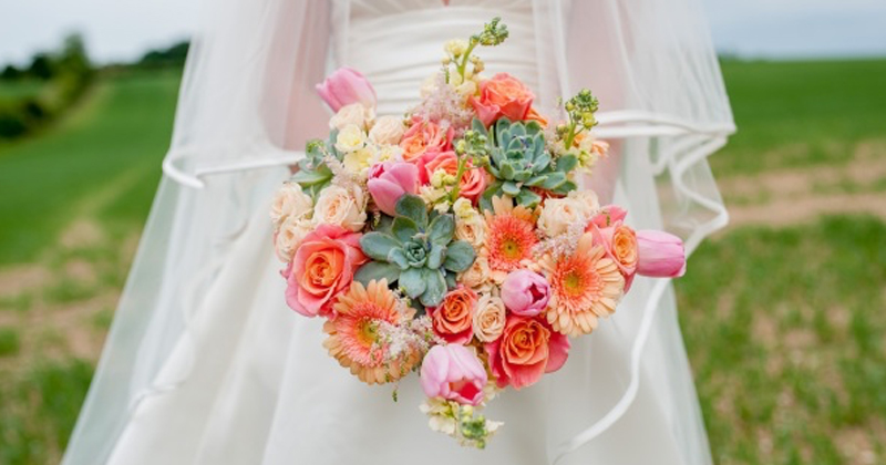 Keep on trend by adding coral flowers to your bouquets and arrangements at your 2019 wedding at Morden Hall.