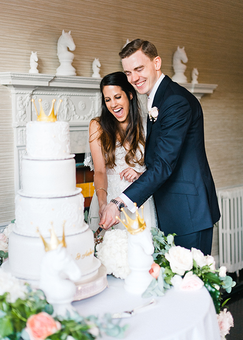 The happy couple cut their wedding cake at Morden Hall in London