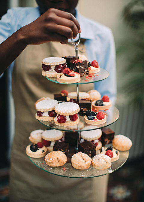 Guests were delighted with tasty chocolate brownies and fruit tartlets at this summer wedding at Morden Hall