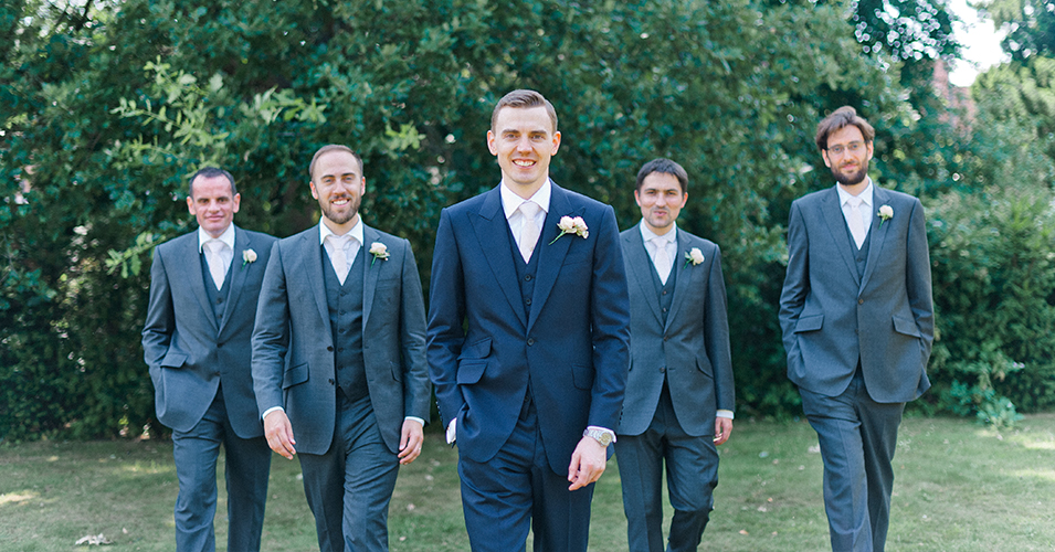The grooms and his groomsmen wore navy three piece suits at this wedding at Morden Hall in London