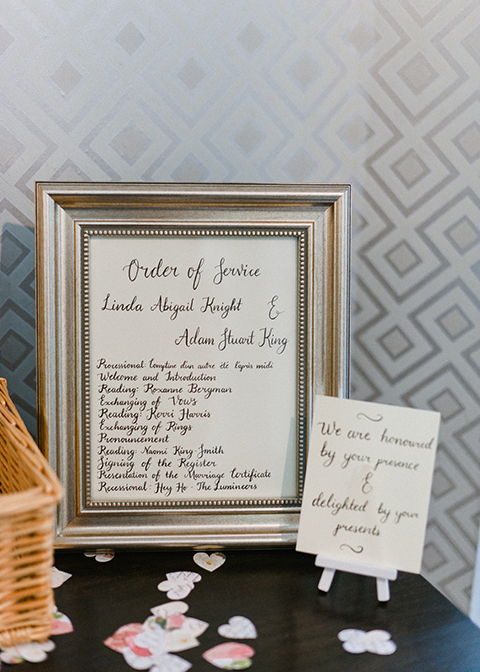 The order service was displayed in an elegant silver frame at this wedding at Morden Hall in London