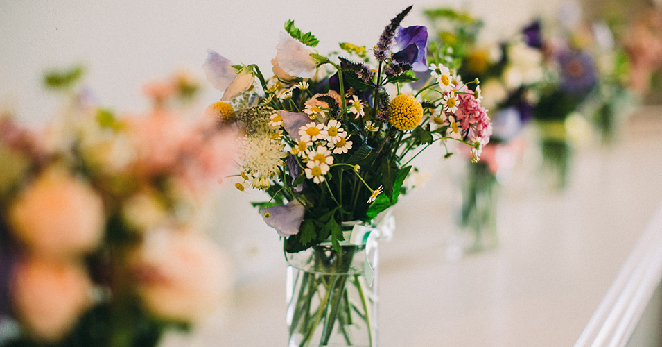 The venue was decorated with vases of colourful summer wedding flowers at this country house wedding in London
