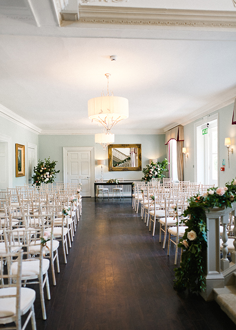 Pretty pink roses were tied to the chairs at this Country House Wedding in London