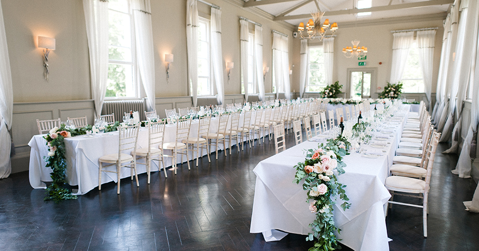 The mulberry suite was set up for the wedding breakfast with beautiful floral garlands across the tables at Morden Hall in London