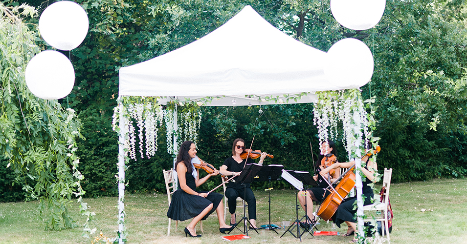 A string quartet played at the drinks reception at this wedding at Morden Hall in London