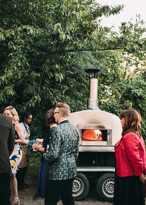 Delicous wood-fired pizza was served at the wedding evening at Morden Hall in London