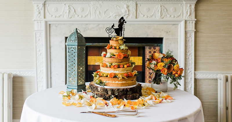 This naked cake is dressed with lots of fresh fruit and flowers at Morden Hall in London