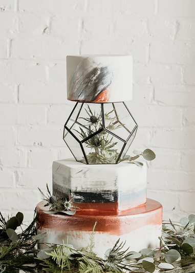 This modern hexagon shaped wedding cake would be perfect for wowing your guests at your wedding at Morden Hall in London