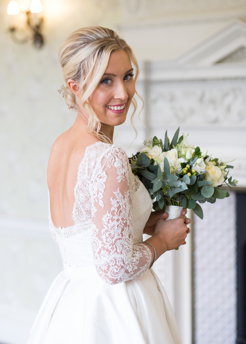 The bride wore a stunning white lace sleeved dress for her winter wedding at Morden Hall