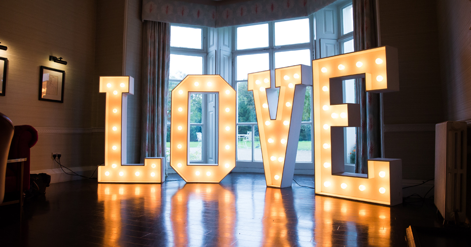 Large love letters lit up the dancefloor at this Country House wedding in London