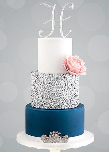 This navy and white wedding cake matches the colour of the grooms wear as well as the wedding dress detail and would be perfect for a wedding at Morden Hall