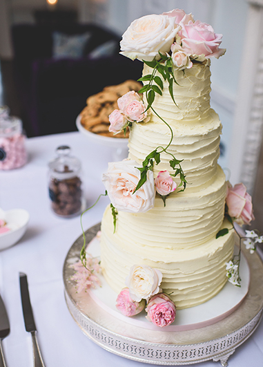 These pale pink roses are the perfect finishing touch to your white iced cake at your wedding at Morden Hall in London