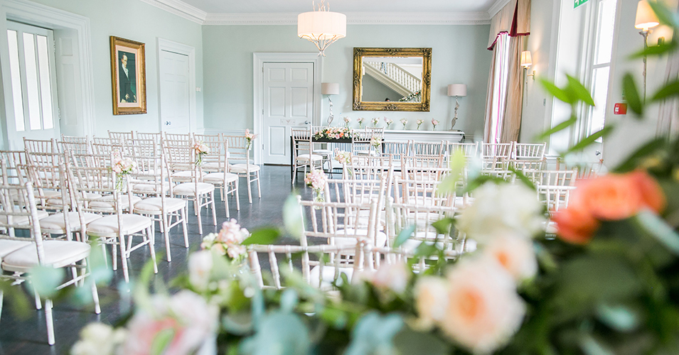 The ceremony room has been decorated with beautiful seasonal wedding flowers at this spring wedding at Morden Hall