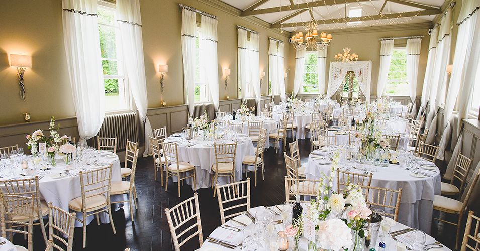 The wedding tables were decorated with arrangements of pretty spring flowers at this wedding venue in London