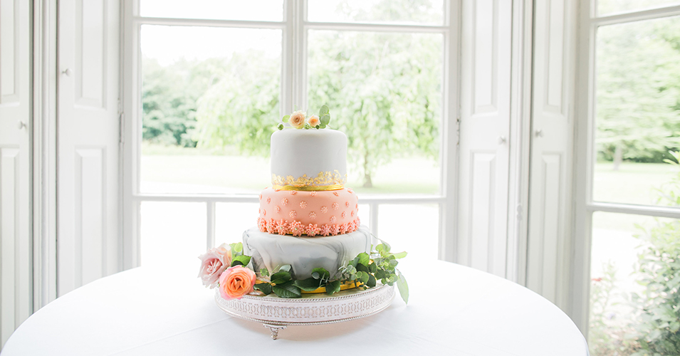 This three tier wedding cake is a perfect choice for a spring wedding at Morden Hall in London
