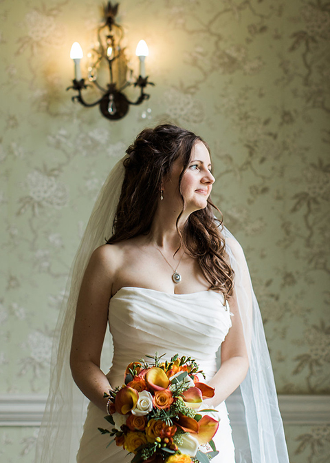 The bride's bouquet was a mix of cream roses and burnt orange flowers for her Autumn wedding at Morden Hall