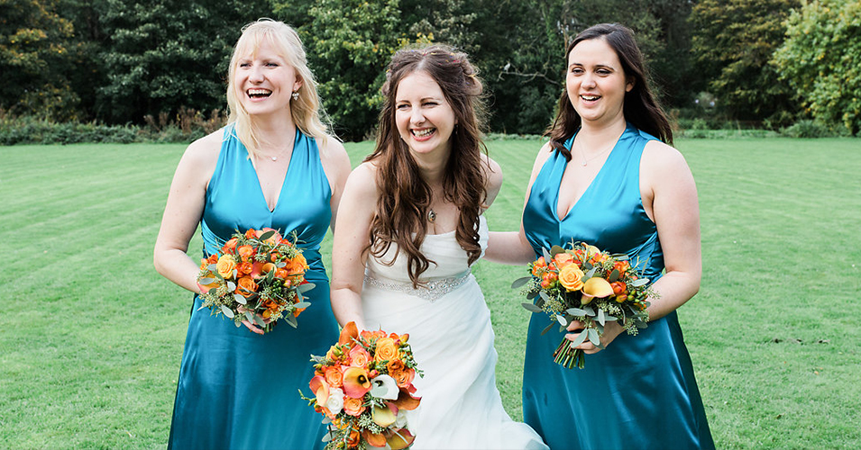 The bridesmaids wore elegant teal dresses at this Autumn wedding at Morden Hall in London