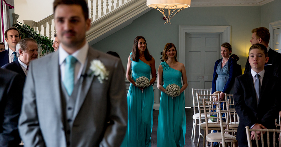 The bridesmaids wore elegant turquoise dresses at this wedding at Morden Hall in London