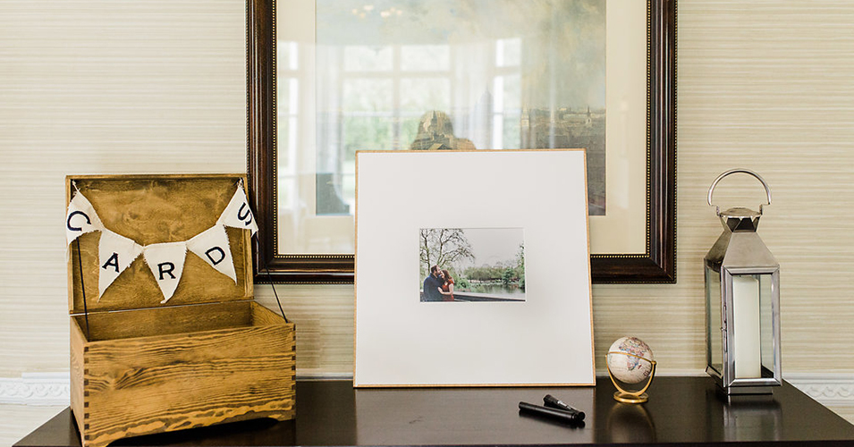 A rustic wooden box was set out for wedding cards and a framed photo of the couple was left for guests to sign at this London wedding