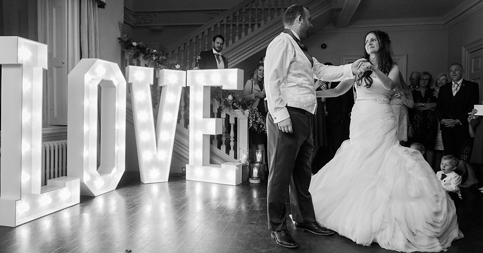 The happy couple enjoy their first dance at their country house wedding in London