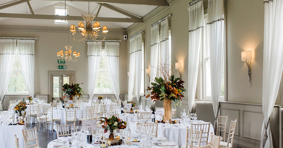The mulberry suite was set up for the wedding breakfast with autumnal table centrepieces at Morden Hall in London