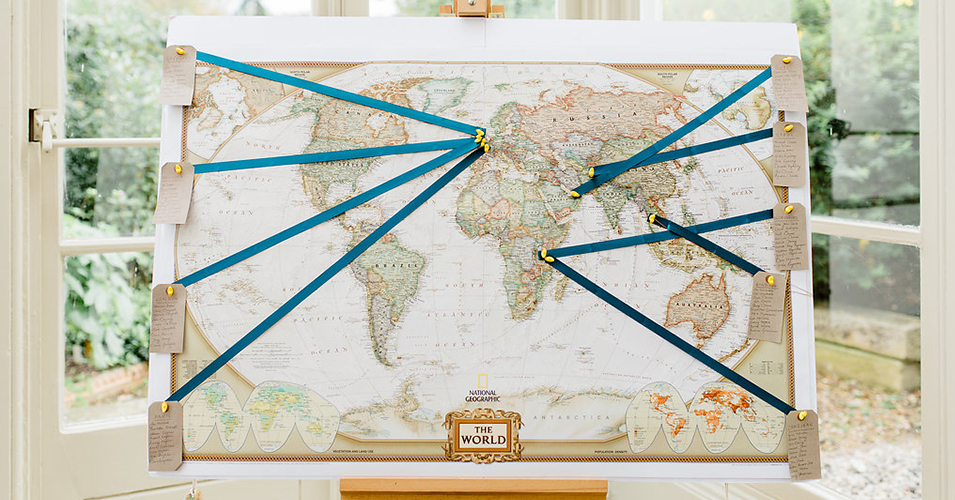 The couple chose a map of the world to display their table plan at this wedding at Morden Hall in London