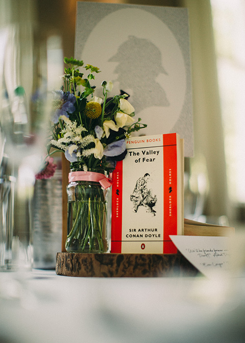 The couples' favourite books were used as part of the table centrepieces at this wedding at Morden Hall