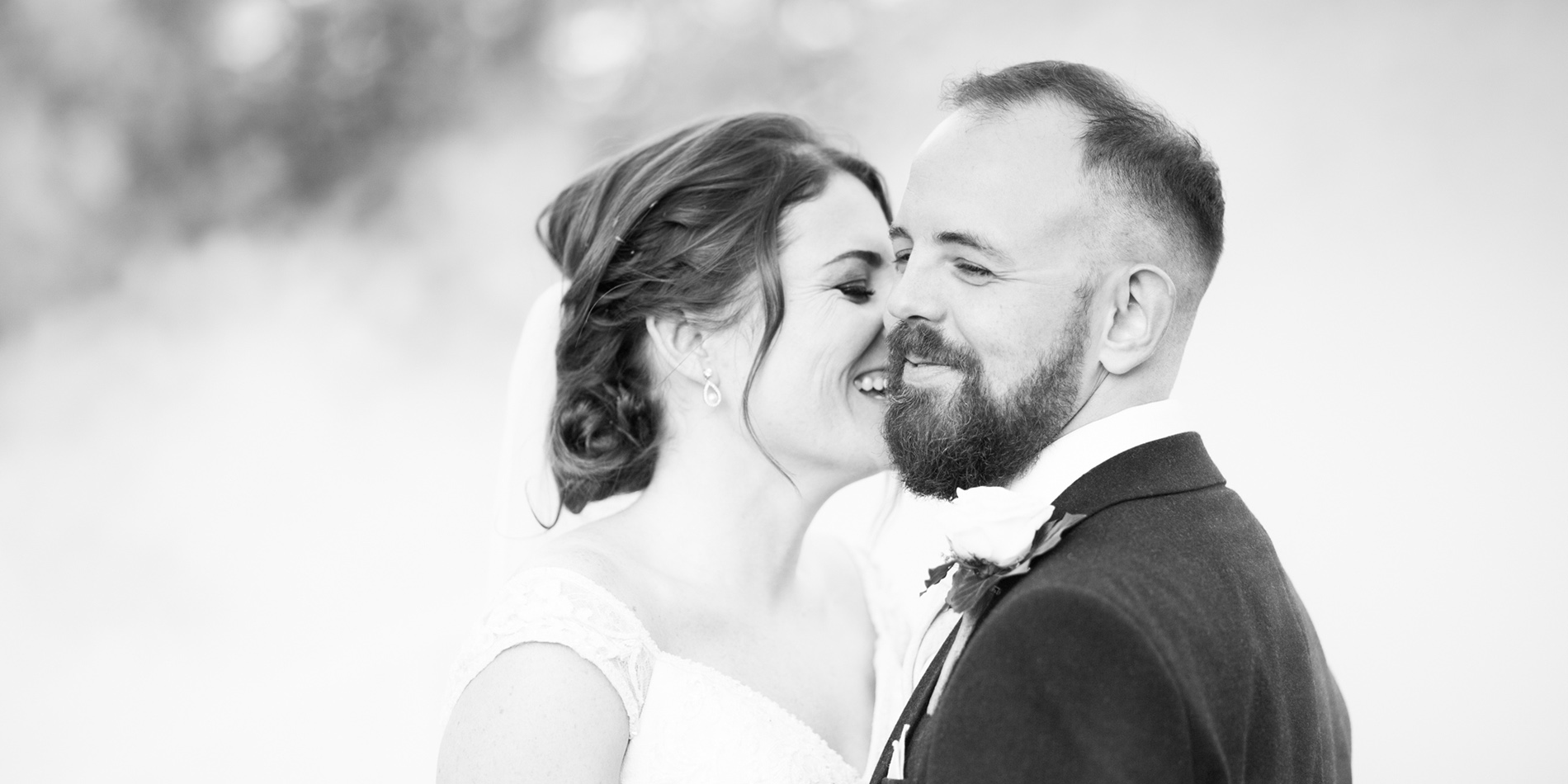 The happy newlyweds share a moment at their wedding at Morden Hall in London