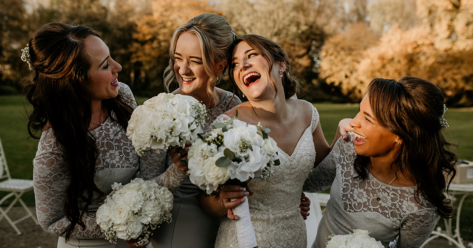 The bridesmaids wore pretty pale grey lace dresses at this wedding at Morden Hall in London
