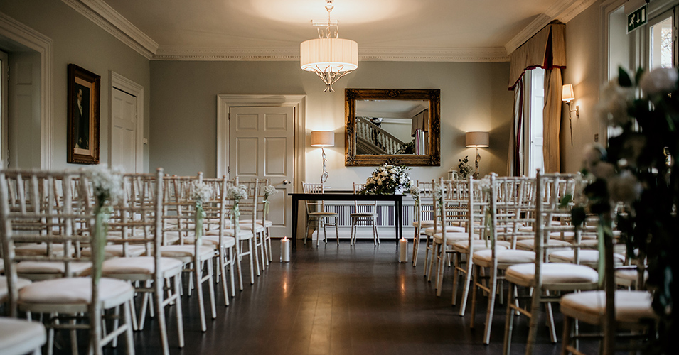 The willow suite was set up for the wedding ceremony at this wedding at Morden Hall