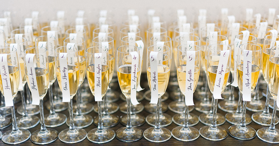Glasses of champagne were labelled with the guests' table numbers at this wedding at Morden Hall in London