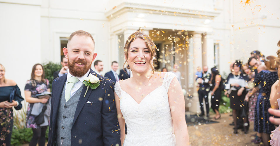 The happy newlyweds have confetti thrown over them at this wedding at Morden Hall in London