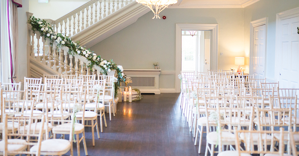 A stunning floral garland was used to decorate the staircase at this country house wedding venue in London