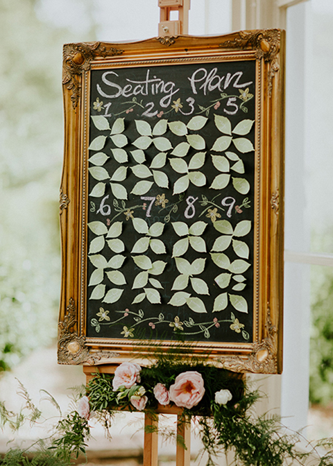 This table was made using paper flowers petals to crate a pretty display and framed in an ornate gold frame