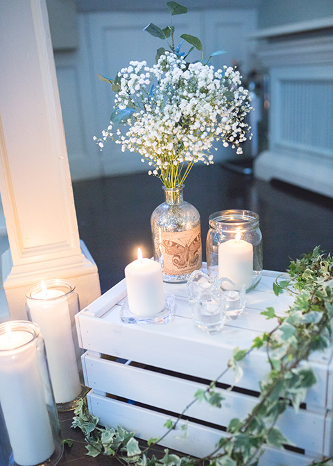 Pretty jars of gypsophila and white pillar candles were used to decorate the venue at this Morden Hall wedding