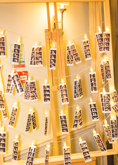 The couple used a wooden easel to display wedding photos at their wedding at Morden Hall in London