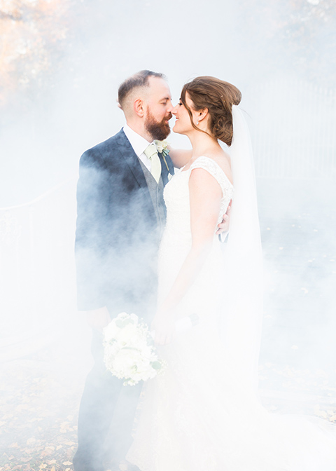 The bride and groom chose to use smoke bombs for added effect to their wedding photos at Morden Hall