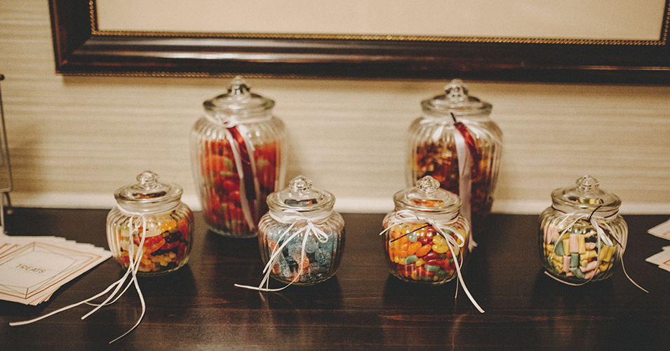 Pretty glass jars were filled with sweets at this country house wedding In London
