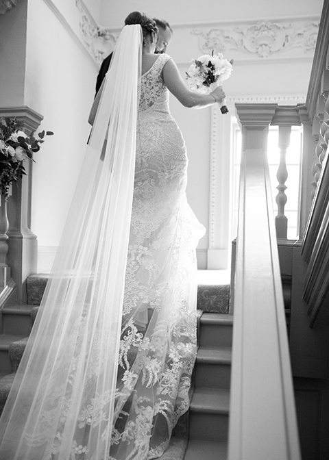 The bride chose a cathedral length veil for her Autumn wedding at Morden Hall