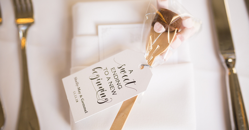 The couple chose hot chocolate spoons as their wedding favours at their autumn wedding at Morden Hall