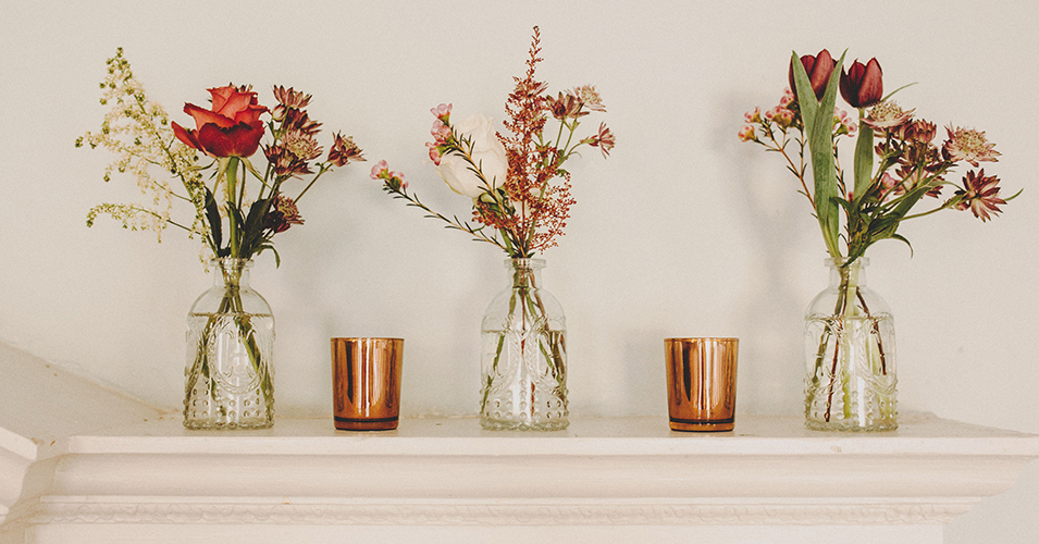 Small bunches of handpicked wedding flowers were displayed in pretty vases on the fireplace at Morden Hall
