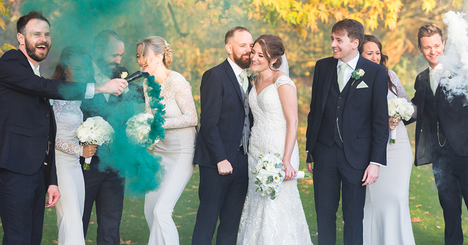 The bridal party set off smoke bombs for added effect at this wedding at Morden Hall in London