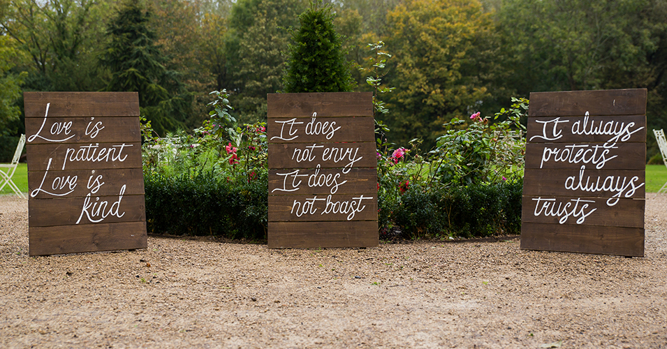 Wooden pallets were used to make wedding signs at this country house wedding in London