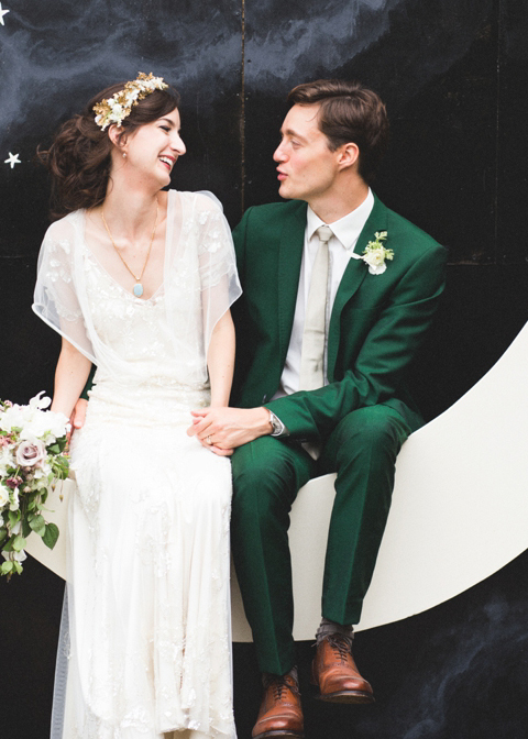 The groom opted for a deep green wedding suit for his wedding in London