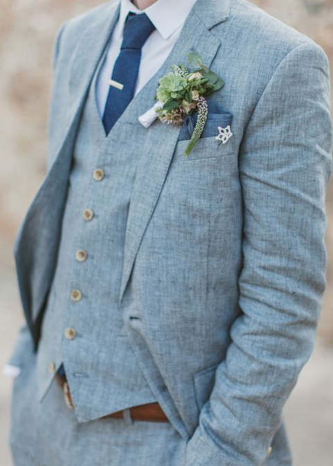 A grey linen three-piece wedding suit is a great choice for a summer wedding at Morden Hall