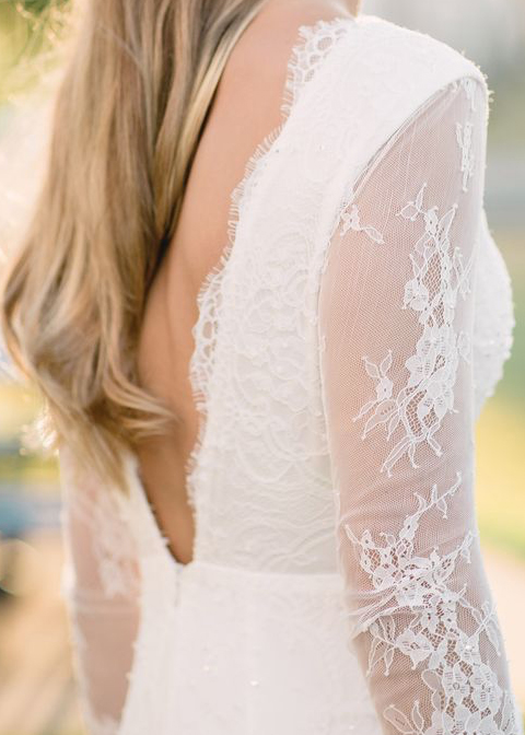 This lace sleeve wedding dress has a low back to keep you cool and stylish for your Morden Hall wedding