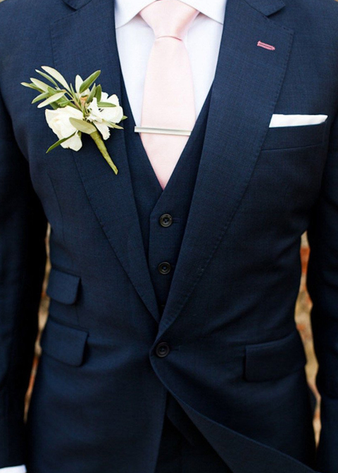 A navy three-piece wedding suit is a great choice for a summer country house wedding in London