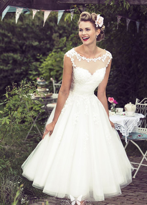 This short length wedding dress is perfect for a country house wedding at in Morden hall in London