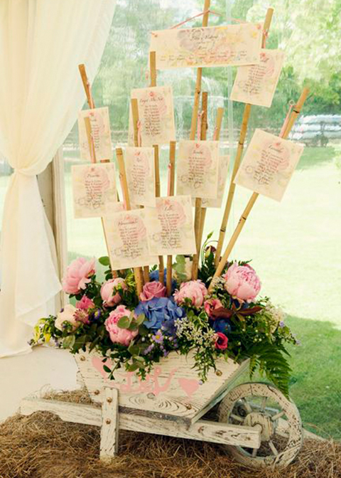 This unique wedding table plan is made from bamboo sticks